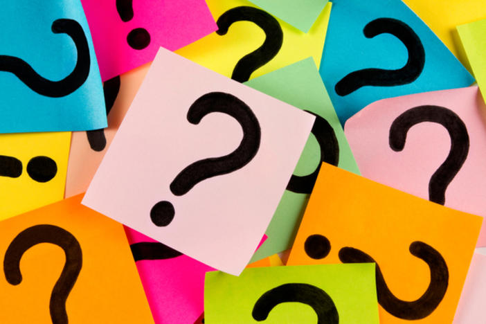 question marks on multi-colored post-its